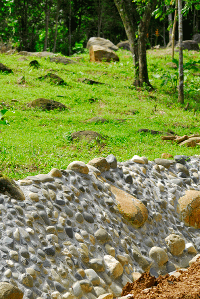 green community uvita uses concrete stone water way and retaining wall to control water